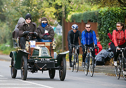 © under license to London News pictures. 07/11/2010. Vintage four-wheeled cars, tricars and motor tricycles taking part in the 77th London to Brighton Veteran Car Run (LBVCR) pass through Crawley, West Sussex today (Sun). The world's longest running motoring even, representing 24 nations, takes the extraordinary automobiles on the 60-mile run from Hyde Park in central London to the seafront on the Sussex resort of Brighton.  Photo credit should read: London News Pictures/LNP
