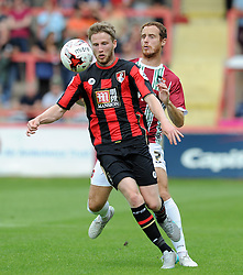 Exeter City's Ryan Harley challenges for the ball with Bournemouth's Eunan O'Kane. - Photo mandatory by-line: Harry Trump/JMP - Mobile: 07966 386802 - 18/07/15 - SPORT - FOOTBALL - Pre Season Fixture - Exeter City v Bournemouth - St James Park, Exeter, England.