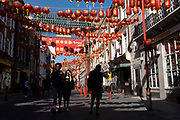 Gerrard Street in Chinatown remains very quiet with a few people visiting Chinese restaurants to pick up food and to see the red lanterns on 25th June 2020 in London, England, United Kingdom. As the July deadline approaces and government will relax its lockdown rules further, the West End remains quiet, while some non-essential shops are allowed to open with individual shops setting up social distancing systems.