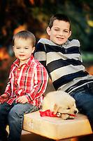 22 December 2013:  Will (7) and Wyatt (2) Skahan with 7 week old puppy Nova in Tustin, CA.