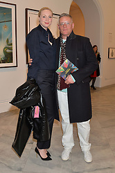 GWENDOLINE CHRISTIE and GILES DEACON at a private view of photographs by David Bailey entitled 'Bailey's Stardust' at the National Portrait Gallery, St.Martin's Place, London on 3rd February 2014.