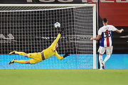 Asmir Begovic (1) of AFC Bournemouth dives the right way but is beaten by the shot from Jaroslaw Jach (33) of Crystal Palace in the penalty shootout during the EFL Cup match between Bournemouth and Crystal Palace at the Vitality Stadium, Bournemouth, England on 15 September 2020.
