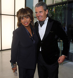 April 30, 2015 - Milan, MILAN, 380 - US singer Tina Turner flanked by unidentify man arrives for a Giorgio Armani exclusive fashion show in Milan, Italy, 30 April, 2015. ANSA/ MATTEO BAZZI (Credit Image: © ANSA/ZUMAPRESS.com)