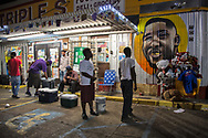 People gather for   a vigil for Alton Sterling on May 2, 2017 in Baton Rouge, Louisiana held in front of  the Trilple S Food Mart U.S. the day news got out that the Justice Department  will not prosecute thee police officer who shot and killed Sterling last summer.