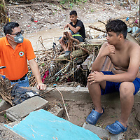 Pastor Julio Caballeros speaks with people in El Calan, Honduras, who have lost their houses in the hurricanes Eta and Iota.