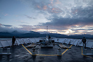 At sunset, passengers on the MV Coho approach Port Angeles, Washington, completing the 90-minute ferry ride from Victoria, British Columbia. (February 13, 2020)