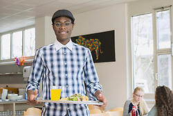 University student with his lunch in plate and smiling School, Bavaria, Germany