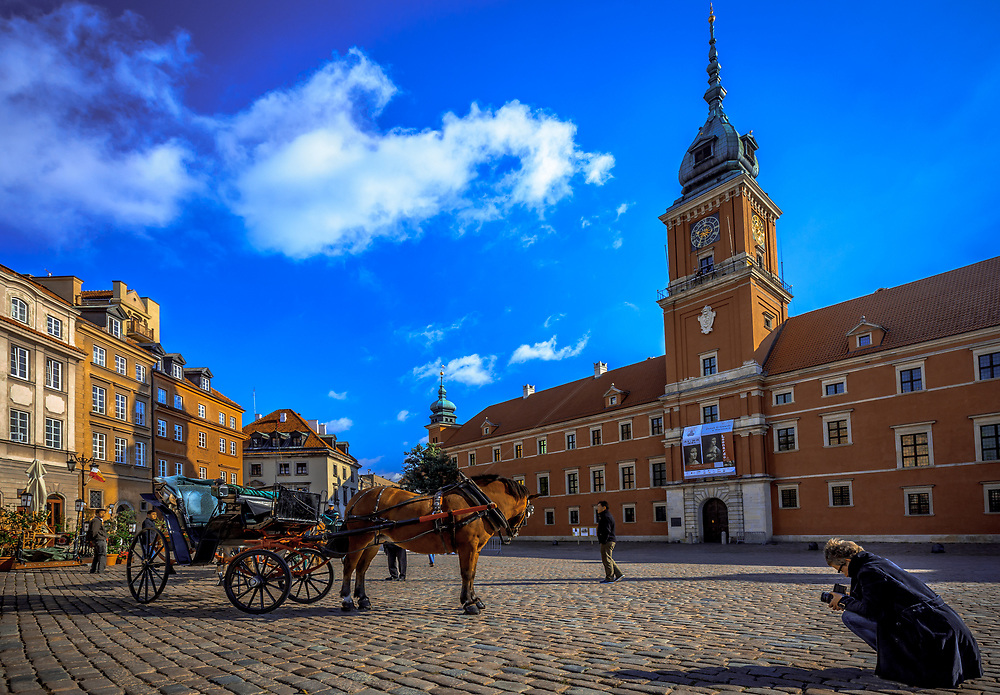 A photographer on Castle Square in Warsaw, Poland.
