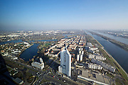 Vienna, Austria. After its opening in February 2014, DC Tower designed by French star architect Dominique Perrault in cooperation with Hoffmann-Janz Architekten is Vienna's highest skyscraper with 250 meters. View over Alte Donau (Old Danube, l.), Donau (Danube river), Donauinsel (Danube Island), Donaucity and Kaisermühlen from the top floor.