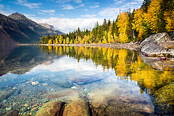 Autumn at Lake McDonald in Glacier National Park. The colors of autumn reflecting upon the crystal clear water it one of Montana's better treats.