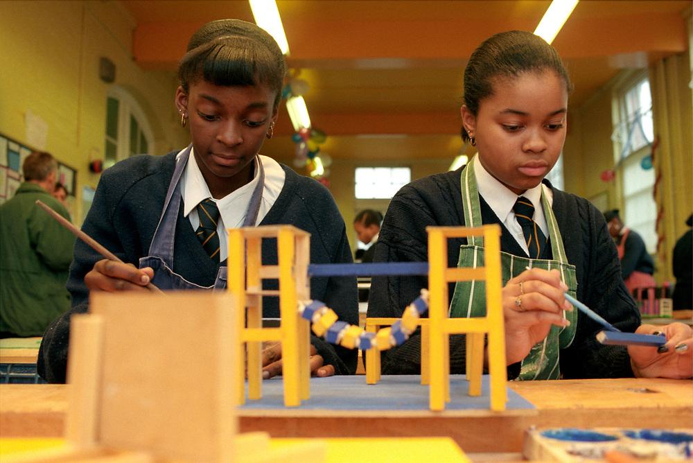 Secondary school pupils doing design technology,