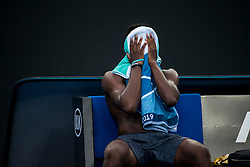 January 18, 2019 - Melbourne, VIC, U.S. - MELBOURNE, AUSTRALIA - JANUARY 18 : Frances Tiafoe of ÊUnited States sinks his head into his towel in disbelieve of winning his match against Andreas Seppi of ÊItaly during day 5 of the Australian Open on January 18 2019, at Melbourne Park in Melbourne, Australia.(Photo by Jason Heidrich/Icon Sportswire) (Credit Image: © Jason Heidrich/Icon SMI via ZUMA Press)