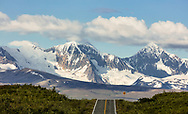 Scenic mountains and glaciers of the eastern Alaska Range as seen from the Denali Highway in Interior Alaska. Summer. Evening.