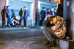 © Licensed to London News Pictures . 01/01/2015 . Manchester , UK . A woman sits slumped on a step next to a puddle of vomit . Revellers usher in the New Year on a night out in Manchester City Centre .  Photo credit : Joel Goodman/LNP