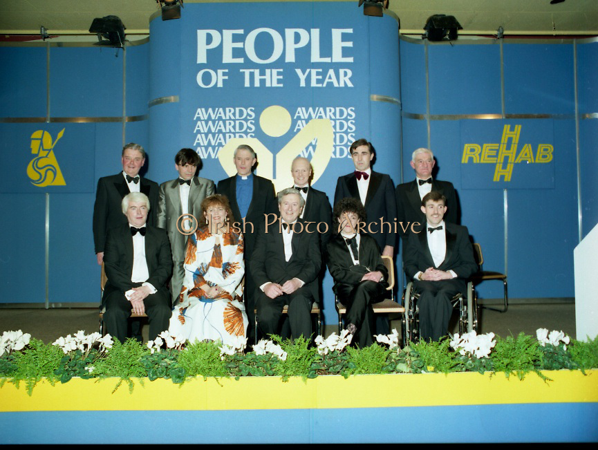 People Of The Year Awards..1986..24.11.1986..11.24.1986..24th November 1986..The 1986 People of the Year Awards,sponsored by New Ireland Assurance and the Rehabilitation Institute,were presented by An Taoiseach,Dr Garrett Fitzgerald at the Burlington Hotel,Dublin..Picture of the award winners with An Taoiseach,Dr Garret Fitzgerald,(centre-front row).(front row)L-R. Mr William Houlihan,Dr Susan McKenna-Lawlor,Ms Garry Hynes and Mr Cathal McDonagh..(back row)L-R. Senator Eoin Ryan,Chairman,New Ireland Assurance,Mr Neil Jordan,Rev Cecil Kerr,Mr Jonjo O'Neill,Mr Denis Brosnan and Prof., Bernard Moran,Chairman Rehabilitation Institute.