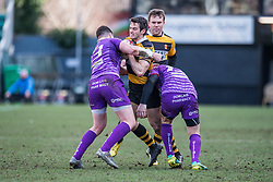 Newport's Elliot Frewen is tackled by Ebbw Vale's James Lewis - Mandatory by-line: Craig Thomas/Replay images - 04/02/2018 - RUGBY - Rodney Parade - Newport, Wales - Newport v Ebbw Vale - Principality Premiership