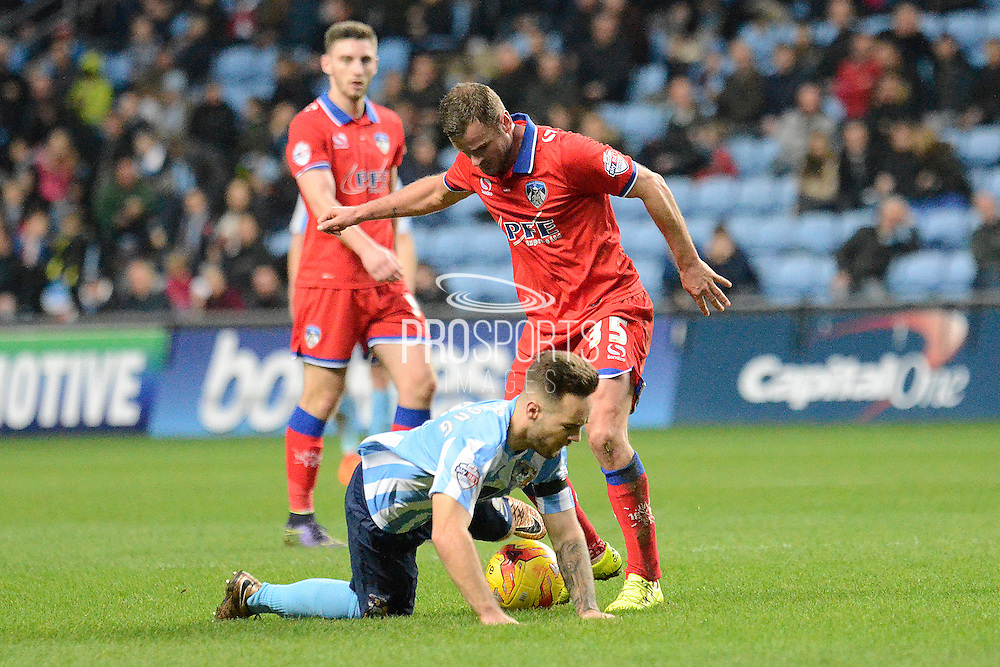 Oldham Athletic midfielder Ritchie Wellens fouls Coventry City striker Adam Armstrong during the Sky Bet League 1 match between Coventry City and Oldham Athletic at the Ricoh Arena, Coventry, England on 19 December 2015. Photo by Alan Franklin.
