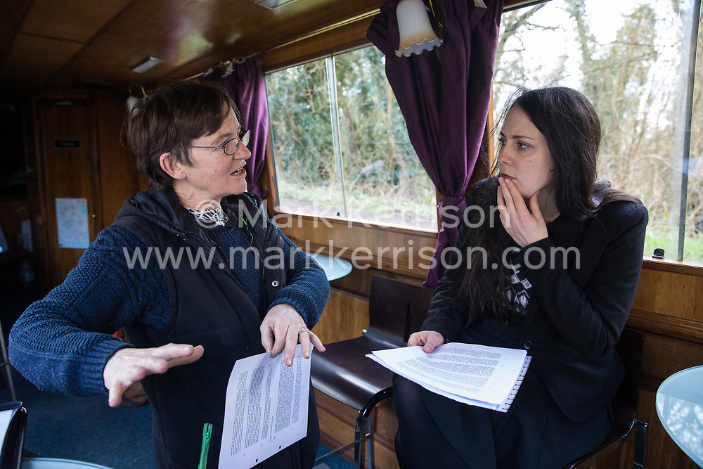 Denham, UK. 11 February, 2020. Amelia Womack (r), Deputy Leader of the Green Party, speaks to Sarah Green (l) of Save the Colne Valley at Denham in the Colne Valley. Contractors working on behalf of HS2 are rerouting electricity pylons through a nearby Site of Metropolitan Importance for Nature Conservation (SMI) in conjunction with the high-speed rail link.