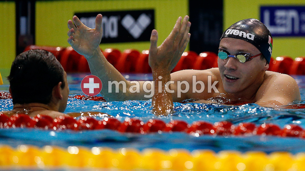Yauhen Tsurkin (R) of Belarus is beeing congratulated by Florent Manaudou of France after they won exe-quo the men's 50m Butterfly Final during the LEN European Swimming Championships at Europa-Sportpark in Berlin, Germany, Tuesday, Aug. 19, 2014. (Photo by Patrick B. Kraemer / MAGICPBK)