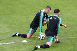 June 4, 2018 - Lisbon, Portugal - Portugal's forward Cristiano Ronaldo chats with Portugal's defender Pepe during a training session at Cidade do Futebol (Football City) training camp in Oeiras, outskirts of Lisbon, on June 4, 2018, ahead of the FIFA World Cup Russia 2018 preparation match against Algeria. (Credit Image: © Pedro Fiuza/NurPhoto via ZUMA Press)