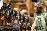 A vendor selling wooden carvings at the 22nd Salon International de l'Artisanat de Ouagadougou (SIAO) in Ouagadougou, Burkina Faso on Sunday November 2, 2008.