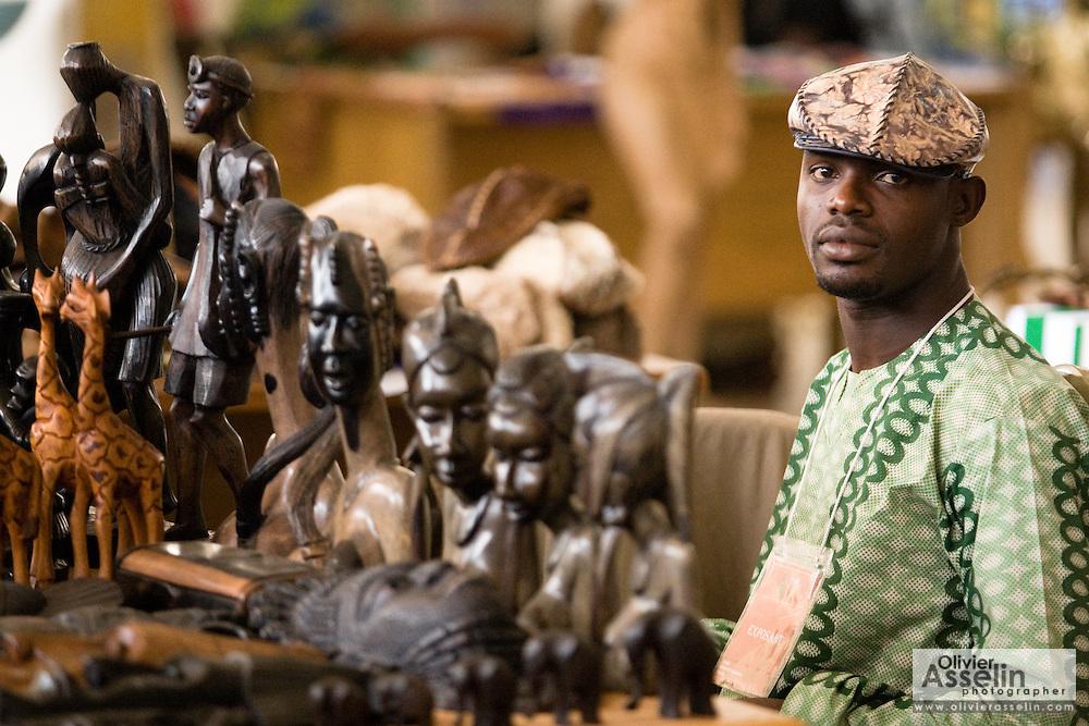 A vendor selling wooden carvings at the 22nd Salon International de l'Artisanat de Ouagadougou (SIAO) in Ouagadougou, Burkina Faso on Sunday November 2, 2008.