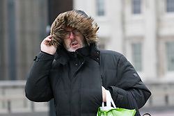 © Licensed to London News Pictures. 09/02/2020. London, UK. A man walks across London Bridge during windy weather this morning. Rain and windy weather is forecast today as Storm Ciara reaches the capital. Photo credit: Vickie Flores/LNP
