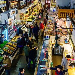 Lancaster, PA / USA - February 14, 2020: Standholder's and shoppers actively engage in commerce at the city's Central Market near Penn Square.