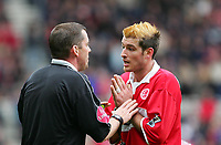 Photo. Andrew Unwin, Digitalsport<br /> Middlesbrough v Arsenal, Barclays Premiership, Riverside Stadium, Middlesbrough 09/04/2005.<br /> Middlesbrough's Franck Queudrue (R) pleads with the referee, Mr P Down (L), as he is booked for a body-check on Arsenal's Jose Reyes