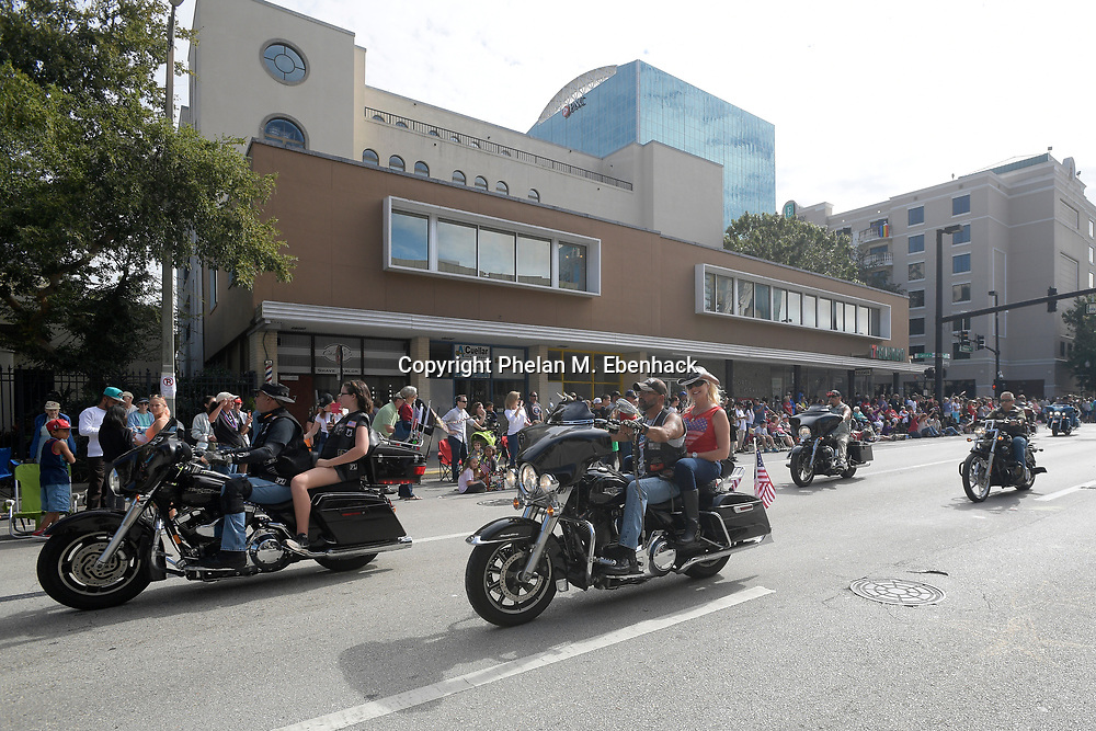 Participants make their way along the route during a Veterans Day Parade in downtown Orlando, Fla., Saturday, Nov. 12, 2016. (Photo by Phelan M. Ebenhack)