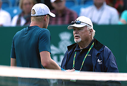 Great Britain's Kyle Edmund talks to Tom Barnes ATP supervisor about replaying a point during day five of the Nature Valley International at Devonshire Park, Eastbourne.