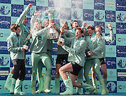 "London. UNITED KINGDOM. ""Champagne Moment"", Cambridge celebrate winning the  162nd BNY Mellon Boat Race Championship Course, River Thames, Putney/Mortlake.  Sunday  27/03/2016    [Mandatory Credit. Intersport Images]<br /> <br /> Cambridge University Boat Club {CUBC} v Oxford University Boat Club {OUBC}<br /> <br /> Cambridge, Crew, Bow: Felix Newman – 83.2kg, 2: Ali Abbasi – 88.4kg, 3: Charles Fisher – 91.8kg, 4: Clemens Auersperg – 90.4kg, 5: Luke Juckett – 82.0kg, 6: Henry Hoffstot –  92.6kg, 7: Ben Ruble – 83.4kg, Stroke: Lance Tredell – 94.2kg, Cox: Ian Middleton – 54.0kg"