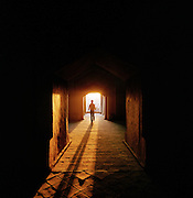 A person walks in the dark corridors of the Uyghur Mosque in Turpan, the second largest city in Gansu province. Northwest China found along the old Silk Route