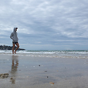 A hooded Quade Cooper walks on the foreshore during the Australian teams recovery session at  Takapuna Beach at the IRB Rugby World Cup tournament, Auckland, New Zealand, 17th October 2011. Photo Tim Clayton...