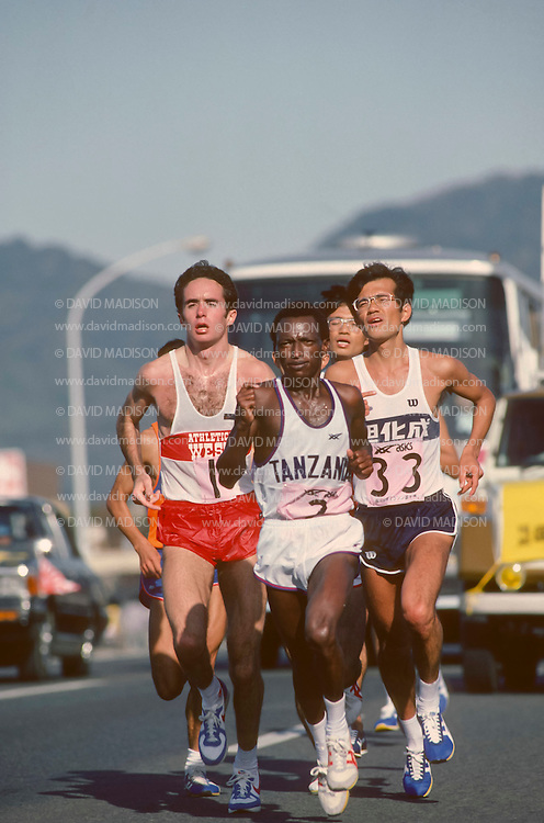 FUKUOKA, JAPAN -  DECEMBER 3:  Alberto Salazar #1 of the USA, Juma Ikangaa #2 of Tanzania, and Shigerou Soh #33 of Japan lead a pack of runners midway in the 1983 Fukuoka International Marathon held on December 3, 1983 in Fukuoka, Japan.  Salazar finished fifth in a time of 2:09:21. (Photo by David Madison/Getty Images) *** Local Caption *** Alberto Salazar;Juma Ikangaa;Shigerou Soh