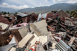 October 4, 2018 - Palu, Central Sulawesi, Indonesia - A member of the Indonesian military looks over a tsunami devastated area, after the earthquake hit the area on September 28, in Balaroa Village on October 4, 2018, Central Sulawesi, Indonesia.  A total of 1,411 people have been confirmed dead and over 2,500 injured after the monster earthquake struck on September 28 sending destructive waves barrelling into Sulawesi island. (Credit Image: © Ivan Damanik/ZUMA Wire)