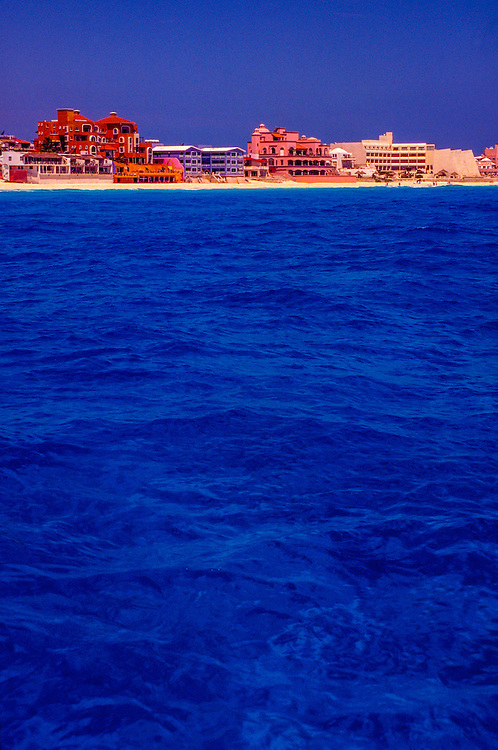 "View of beach properties in Cancun, Mexico (Orange building is ""Baccara"", Caribbean Sea, Cancun, Mexico"