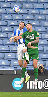 Preston North End's Patrick Bauer battles with Huddersfield Town's Richard Stearman<br /> <br /> Photographer Dave Howarth/CameraSport<br /> <br /> The EFL Sky Bet Championship - Huddersfield Town v Preston North End - Saturday 24 October 2020 - The John Smith's Stadium - Huddersfield<br /> <br /> World Copyright © 2020 CameraSport. All rights reserved. 43 Linden Ave. Countesthorpe. Leicester. England. LE8 5PG - Tel: +44 (0) 116 277 4147 - admin@camerasport.com - www.camerasport.com