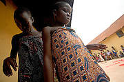 Young girls from the Krobo tribal group perform a traditional dance before their peers as they undergo puberty rites - locally called dipo - in Somanya, Eastern Region, Ghana.