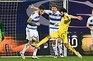 QPR Defender Geoff Cameron(20)(c) QPR Defender Rob Dickie(4) and Brentford Goalkeeper David Raya Martin(1)  during the EFL Sky Bet Championship match between Queens Park Rangers and Brentford at the Kiyan Prince Foundation Stadium, London, England on 17 February 2021.