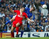 Photo Aidan Ellis.<br />Everton v Liverpool (FA Barclaycard Premiership)<br />19/04/2003.<br />Liverpool's Milan Baros and Everton's Alan Stubbs