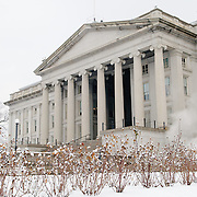 The northern front of the Treasury Building in Washington DC, with a fresh blanket of snow in the foreground.