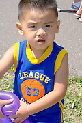 Young one year old Asian American boy dressed in tank top. Dragon Festival Lake Phalen Park St Paul Minnesota USA