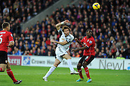 Swansea's Michu (l) watches as his shot at goal goes over the crossbar.  Barclays Premier League match, Cardiff city v Swansea city at the Cardiff city stadium in Cardiff, South Wales on Sunday 3rd Nov 2013. pic by Andrew Orchard, Andrew Orchard sports photography,