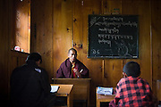 Young monks study Tibetan at the Buddhist monastery in Lukla,  Khumbu (Everest) region, Himalaya Mountains, Nepal.