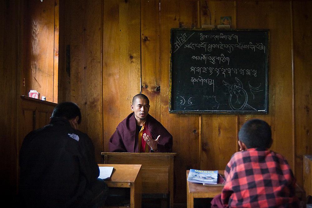 Young monks study Tibetan at the Buddhist monastery in Lukla,  Khumbu (Everest) region, Himalaya Mountains, Nepal.