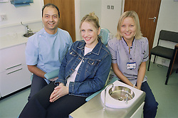 Dental team and patient in surgery,