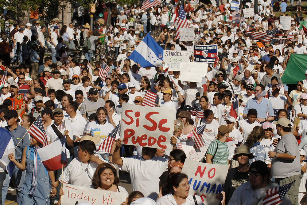 """Austin, TX April 10, 2006: About 20,000 demonstrators march through downtown Austin as immigrant rights supporters staged mass protests nationwide in a """"day of action."""" ©Bob Daemmrich/"""