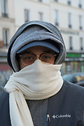 """March, 31st 2020 - Paris, Ile-de-France, France: Parisians wearing a range of masks and facial coverings in the hope of protecting themselves from the spread of the Coronavirus, during the fourteenth day of near total lockdown imposed in France. A week after President of France, Emmanuel Macron, said the citizens must stay at home for at least 15 days, now extended a further two weeks. He said """"We are at war, a public health war, certainly but we are at war, against an invisible and elusive enemy"""". All journeys outside the home unless justified for essential professional or health reasons are outlawed. Anyone flouting the new regulations is fined. Nigel Dickinson"""