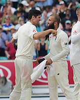 Cricket - 2017 South Africa Tour of England - Third Test, Day Five<br /> <br /> Moeen Ali is congratulated by Alastair Cook after getting a hat trick of wickets (the first since 1938 for a spin bowler) during the afternoon session, at The Oval.<br /> The third wicket was of Morne Morkel<br /> <br /> COLORSPORT/ANDREW COWIE